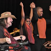 VEE members (Katharine Burnett, Rusty Taylor, and Charles Mason Jr.) raise hands in as they prepare to bow from standing ovation at their Kickoff Concert.