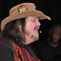 Rusty Taylor sings with cowboy hat on The Shepherd Center for Voices Enabled Ensemble (VEE) Kickoff Concert.