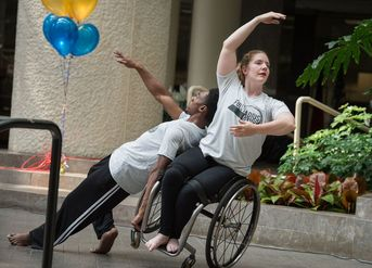 Members of Full Radius Dance Company perform at a Fulton County Disability Awareness Expo celebrating ADA.