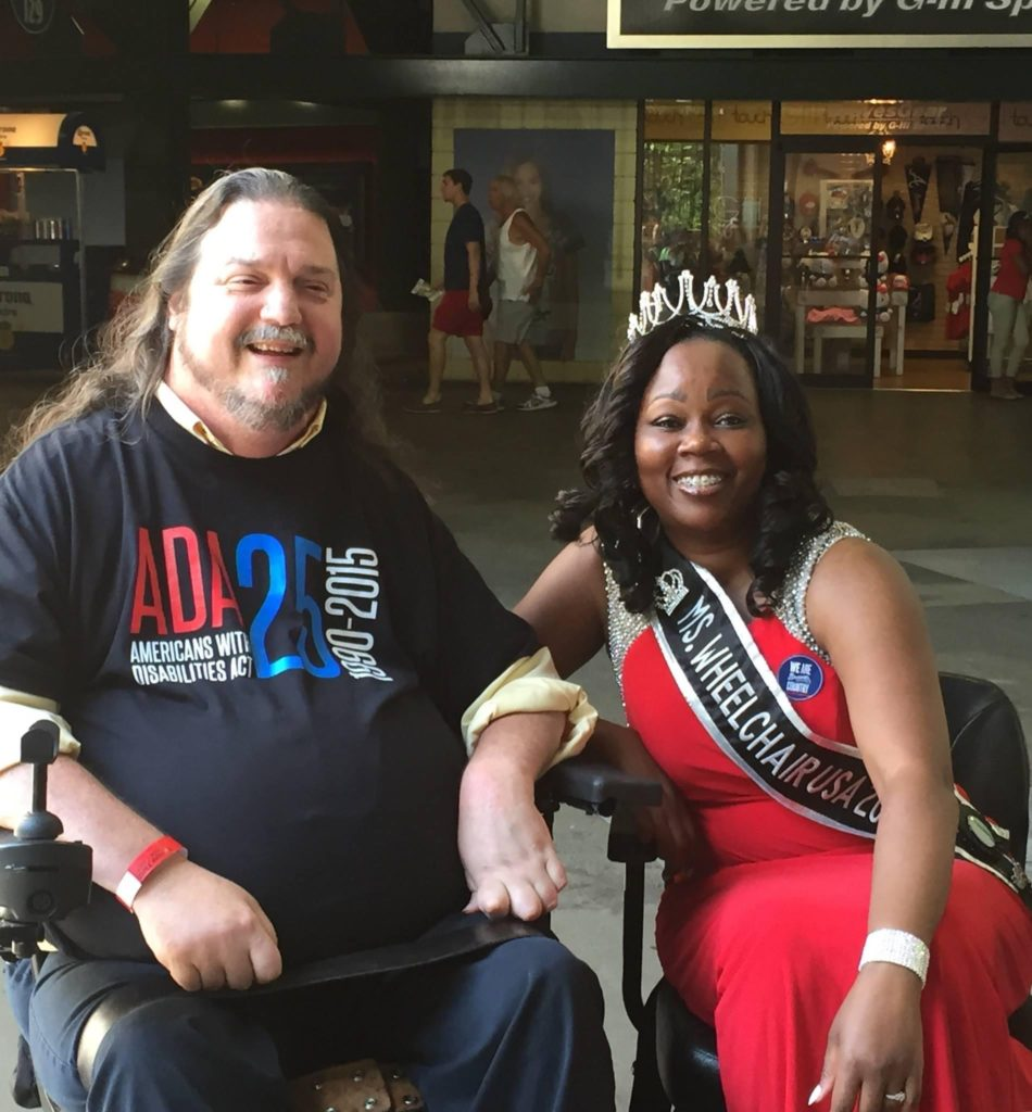 Mrs. Wheelchair International, Yvette Peguese, pictured with wheelchair user, Rusty Taylor.