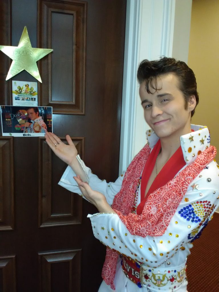 DELVIS (teen singer and Elvis Entity) points to his star on his dressing room before he takes the stage to perform.