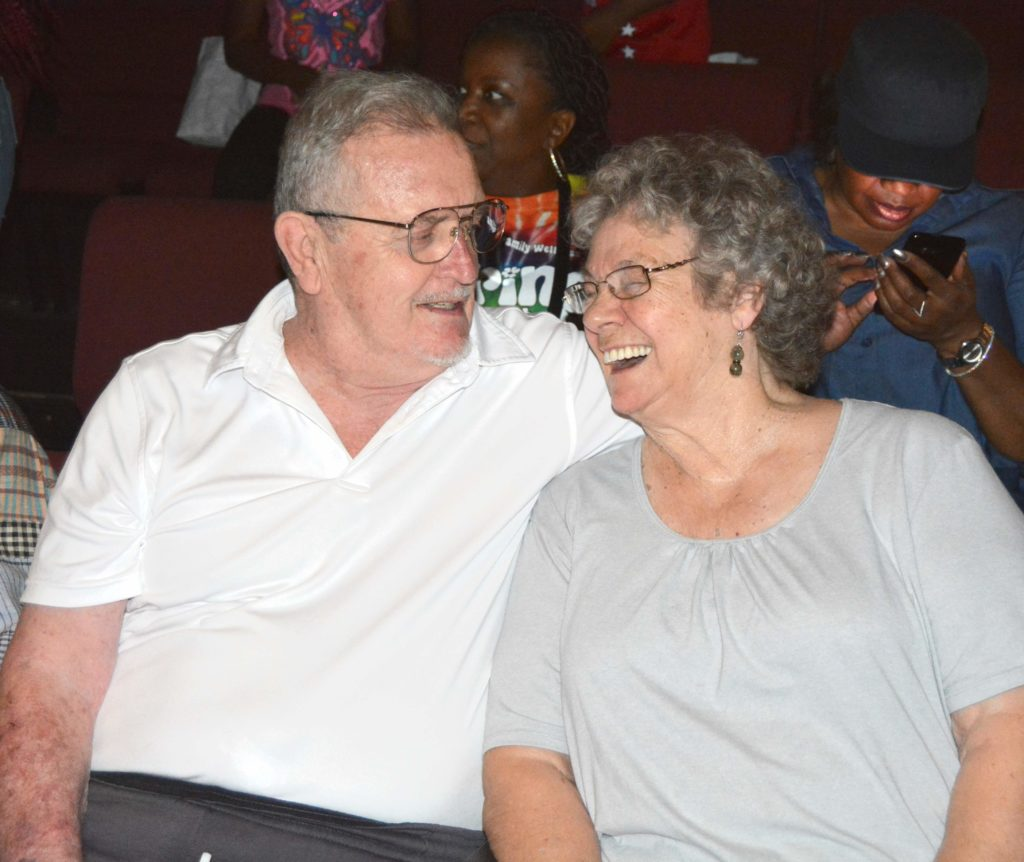 Photo of Bob and Pat Taylor, Rusty's parents , smiling enjoying the SHOWAbility concert.