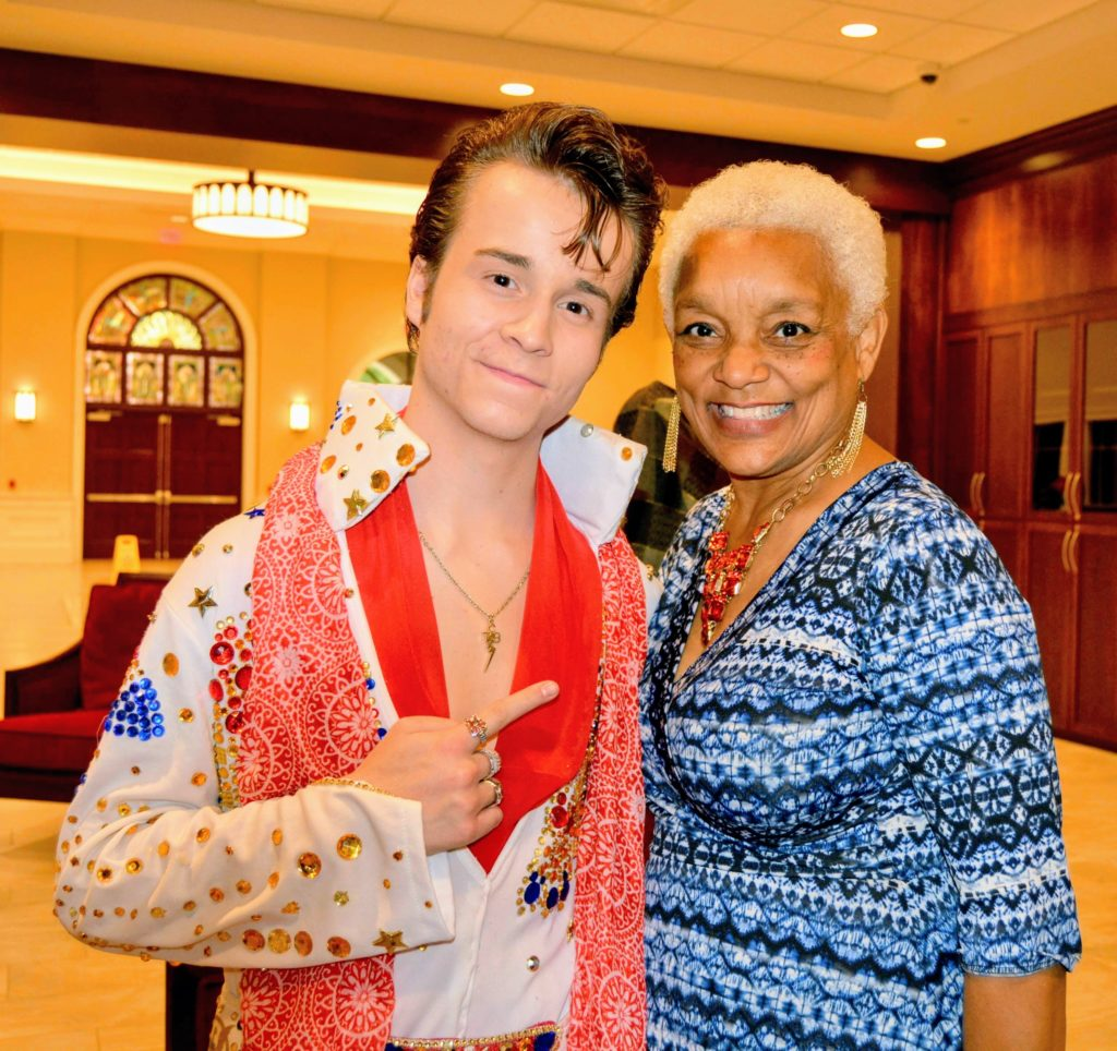 DELVIS (teen singer and Elvis Entity) smiles in photo with SHOWAbility Executive Director Myrna Clayton.