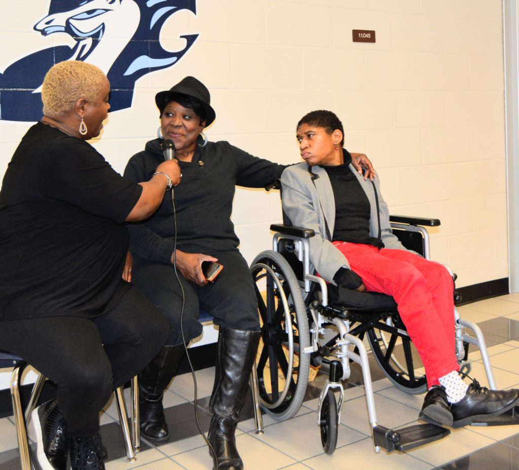 SHOWAbility Board Chair Twanda Black interviews Board member Norma Stanley with her daughter, Sierra, at the Disability Awareness Career Day.