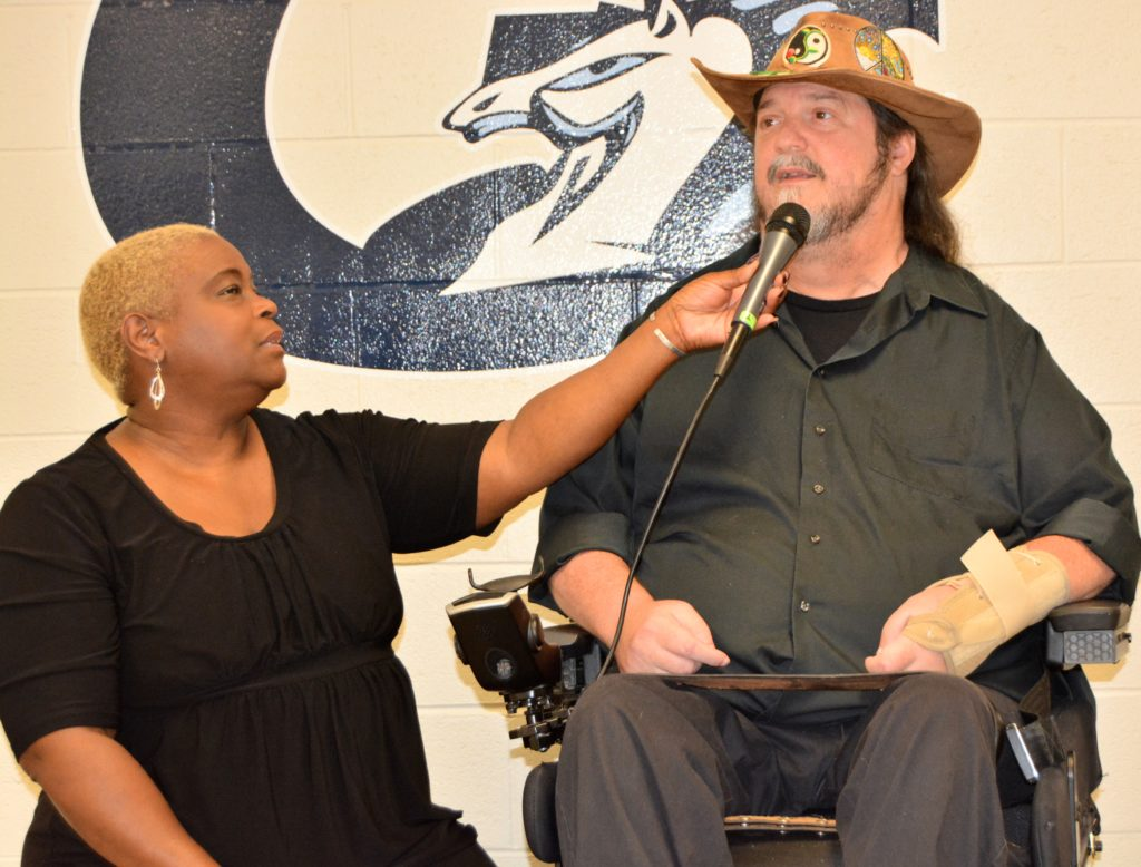 SHOWAbility Board Chair Twanda Black interviews Jazz singer Rusty Taylor (wheelchair user) at the Disability Awareness Career Day.