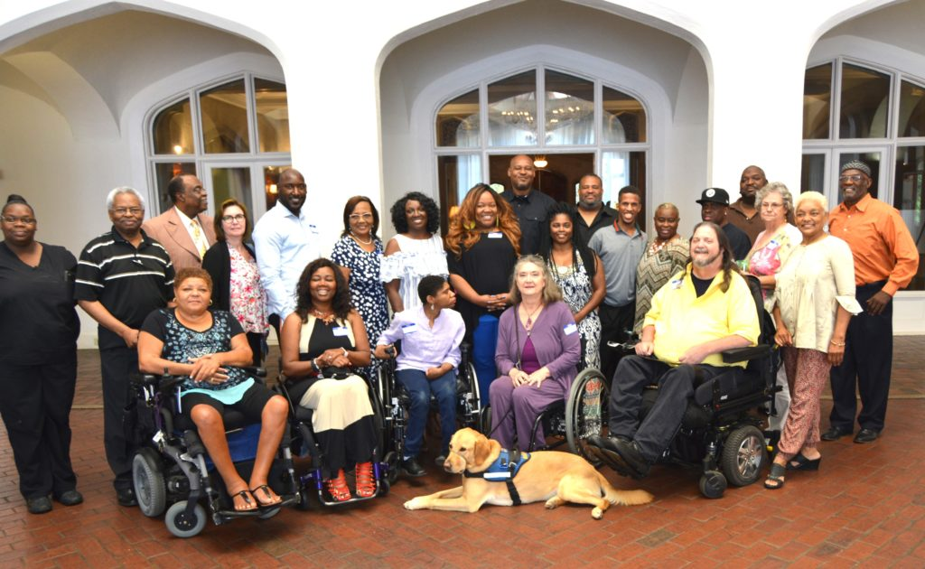 Group photo of some of people who attended SHOWAbility's Community Meet & Greet at Callanwolde Fine Arts Center.