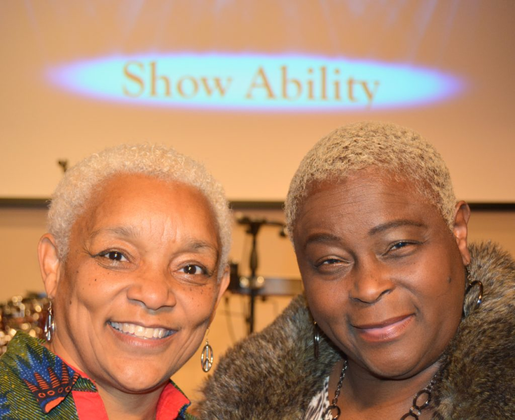SHOWAbility Executive Director Myrna Clayton and Board CHair Twanda Black smile in photo together.