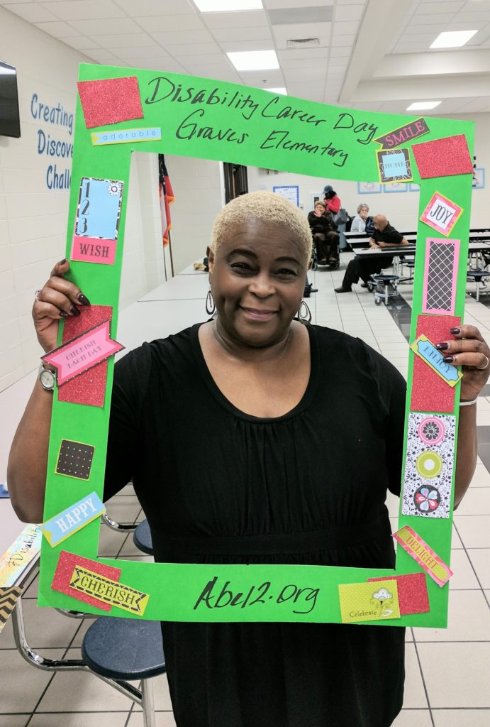 SHOWAbility Board Chair Twanda Black with selfie image picture frame for at the Disability Awareness Career Day.