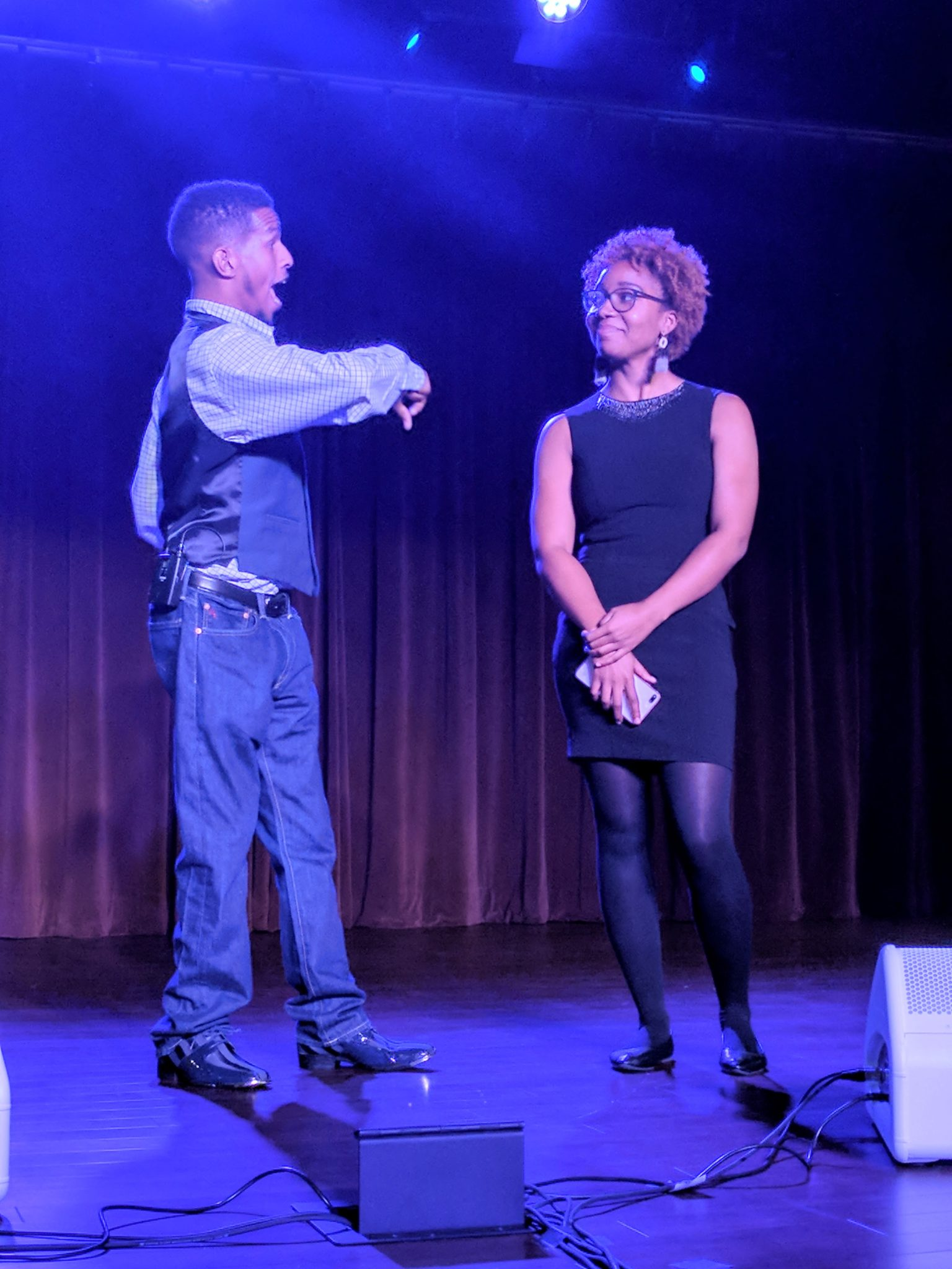 Mr. MiraKool (comedian with cerebral palsy) is pictured teasing SHOWAbility BOard member Maia Miller as part of his comedy act.