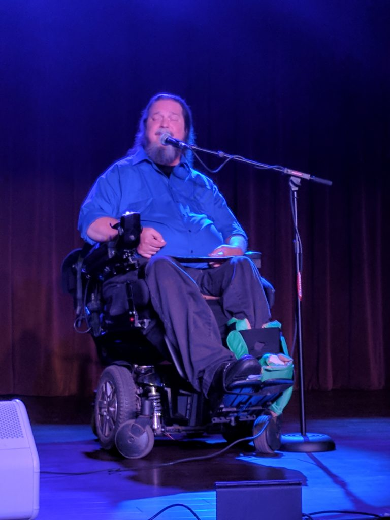 Rusty Taylor, wheelchair user, sings Jazz.