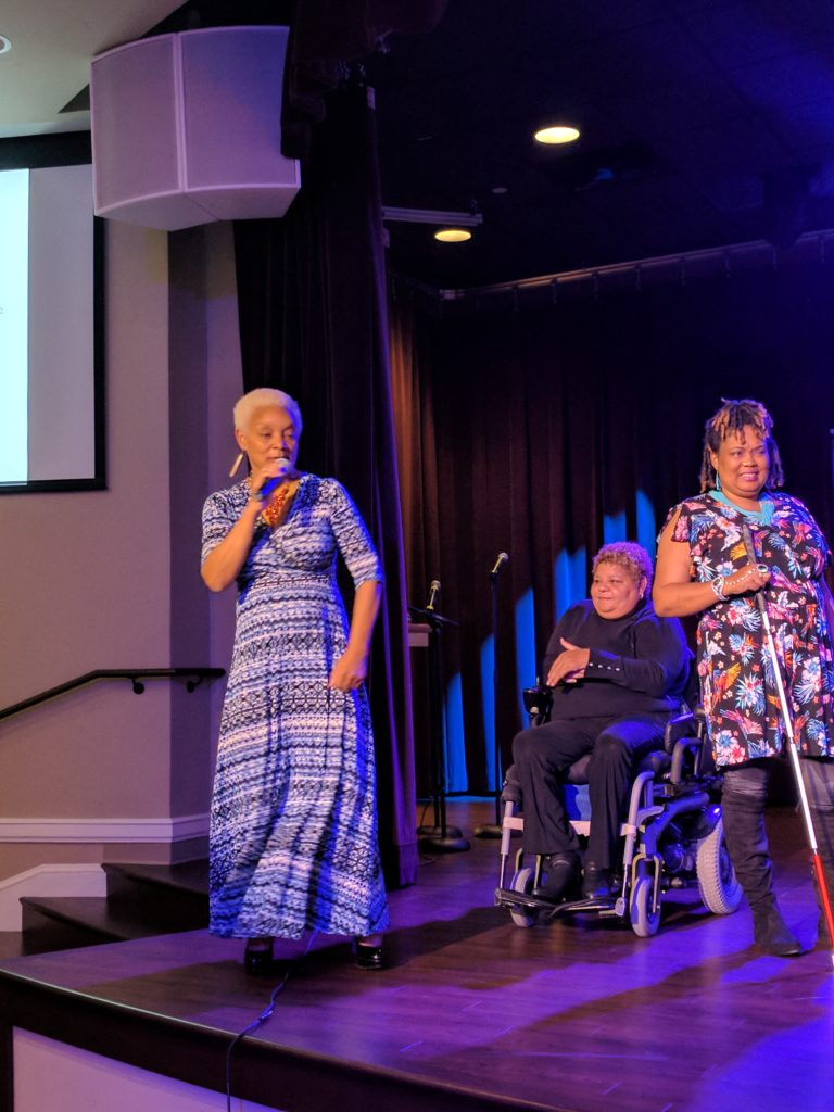 SHOWAbility Executive Director Myrna Clayton sings as fashion models on the disability spectrum showcase their fashions.