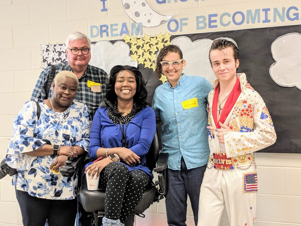 SHOWAbility Board Chair Twanda Black, SHOWAbility supporter David Bell, Mrs. Wheelchair International, Yvette Peguese, Martha Anger (actor and deaf film professional), and DELVIS (teen singer and Elvis Entity) take a photo together at the Disability Awareness Career Day.
