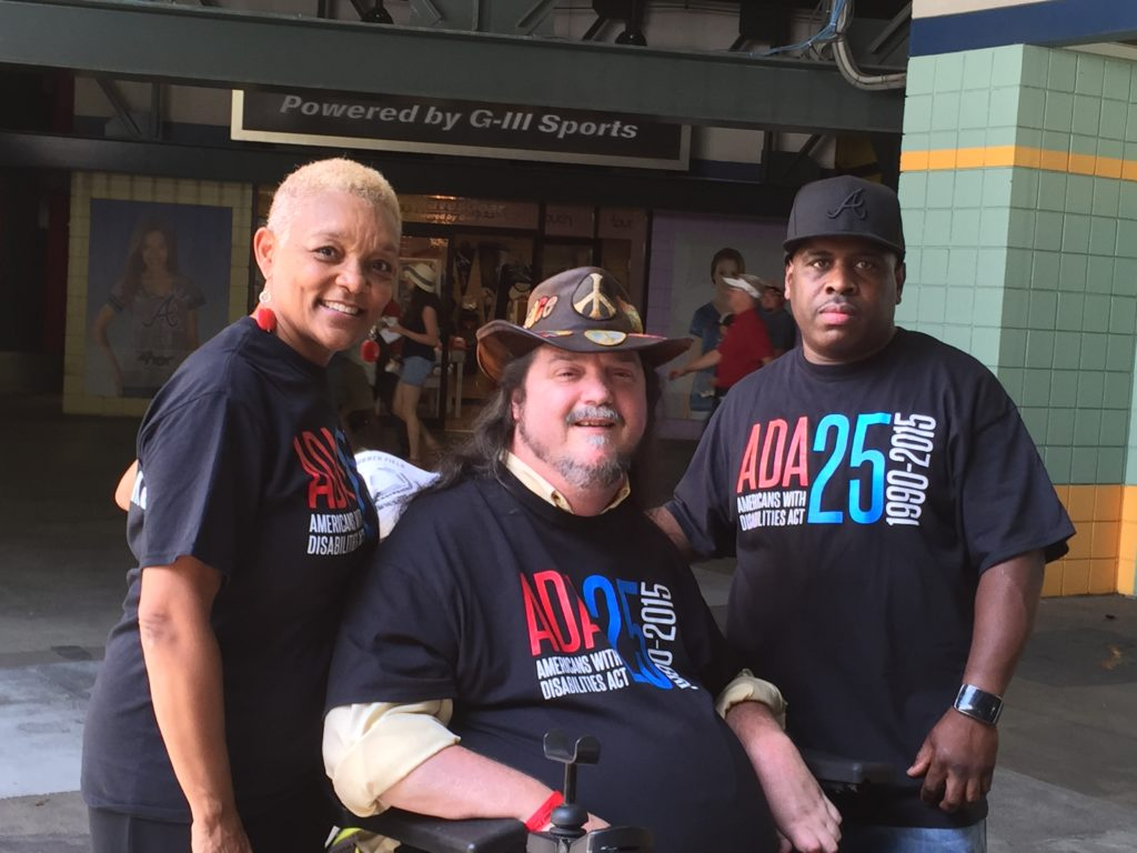 Wheelchair user, Rusty Taylor, pictured with SHOWAbility Executive Director Myrna Clayton and another disability advocate.