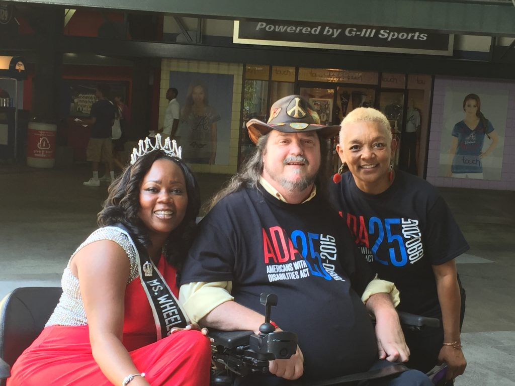 Mrs. Wheelchair International, Yvette Peguese, pictured with wheelchair user, Rusty Taylor and SHOWAbility Executive Director Myrna Clayton