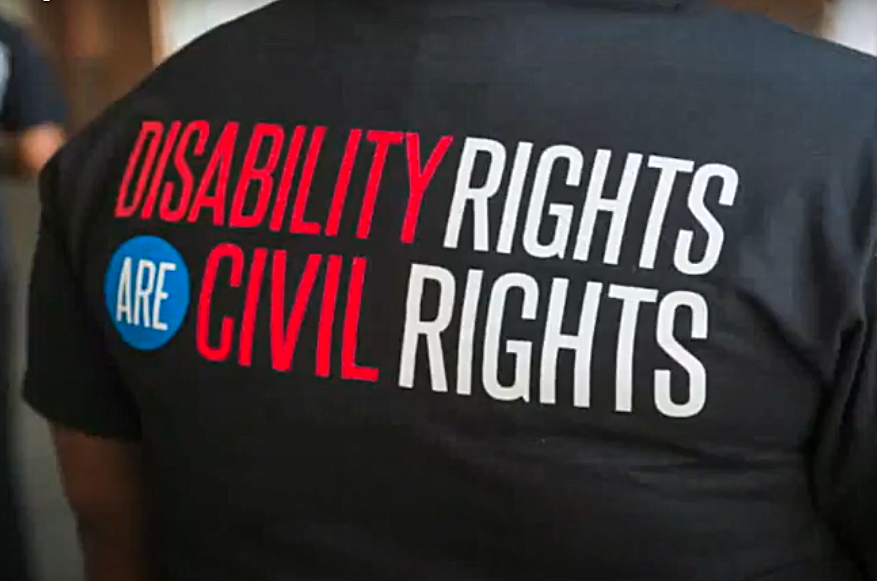 Back of tee shirt which reads, Disability Rights are Civil Rights